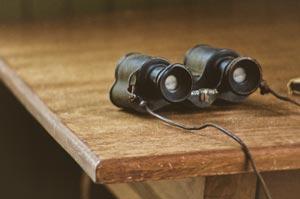 binoculars on a table