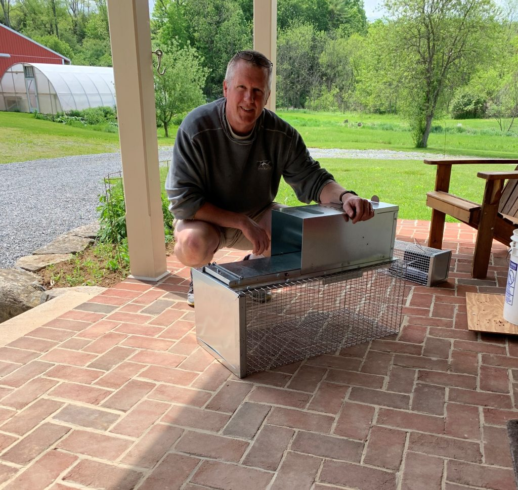 Duane on porch with Uhlik Repeater trap