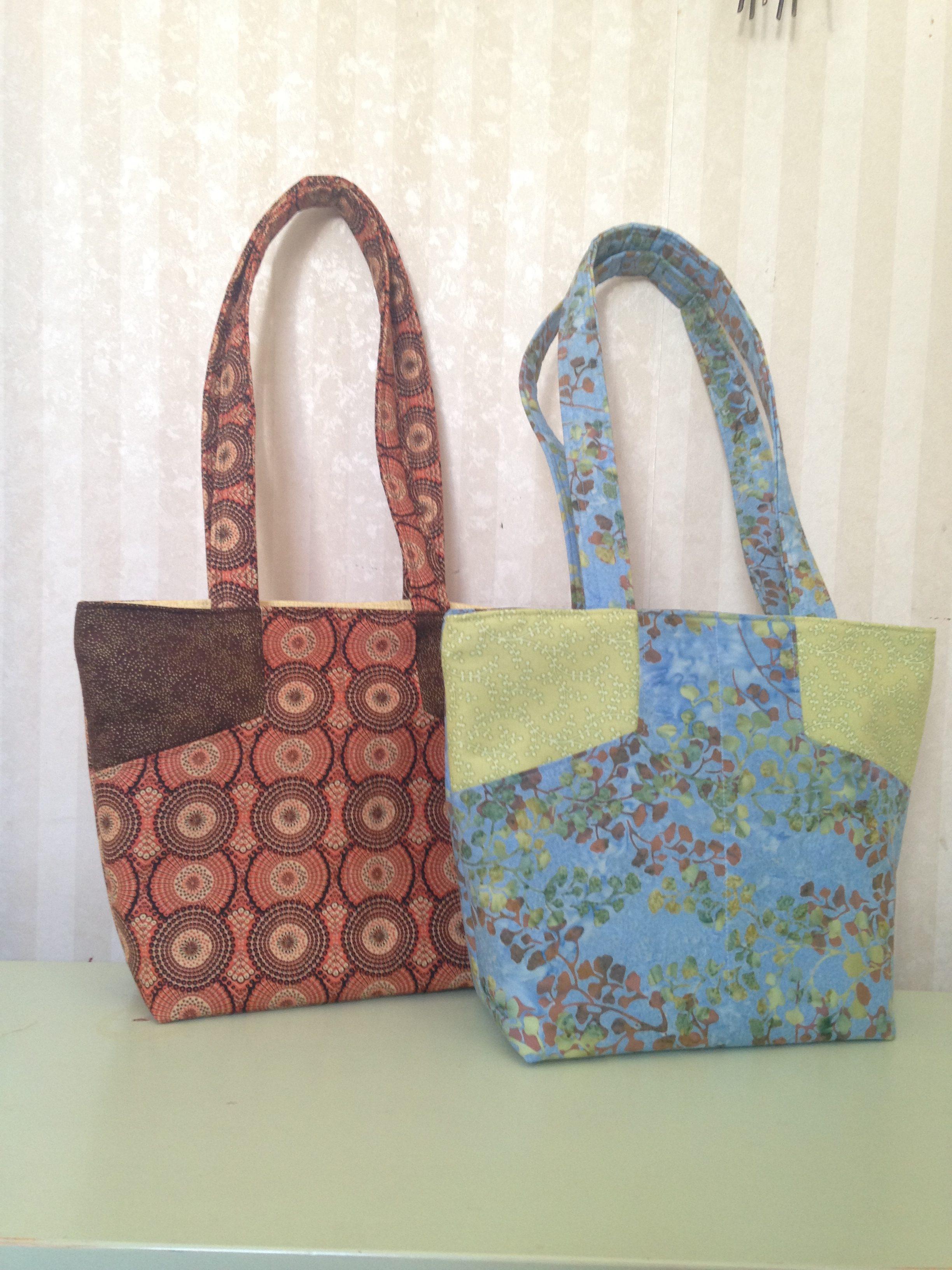 1 orange and 1 blue handmade purse with strap