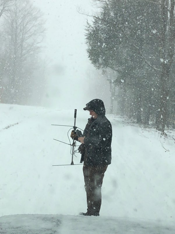 Carolyn in spring snow storm with antenna