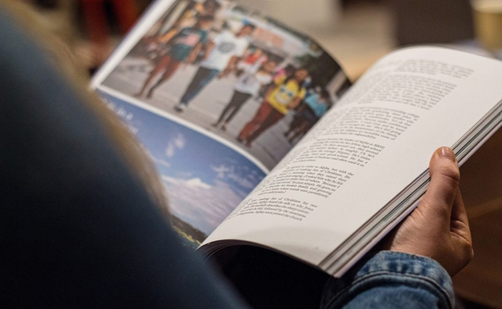 person reading a periodical